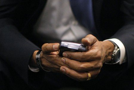 Obama con su BlackBerry